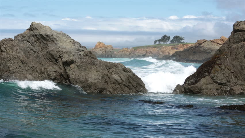 Beautiful Pacific Ocean waves rocky point California. Pacific Ocean waves. Coastal California ocean beach, cliff and beautiful scenery along coast. Blue water and waves crashing along beach and rocks. - HD stock footage clip