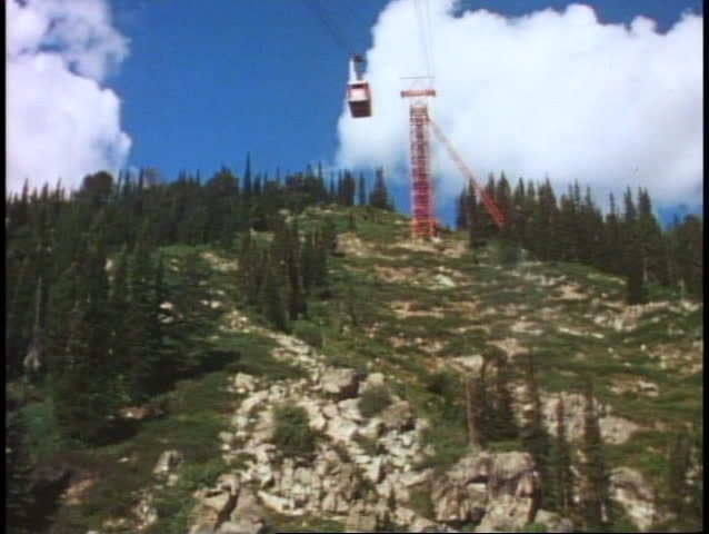 POV from tram, wide shot, passing downward tram, Jackson Hole, Wyoming