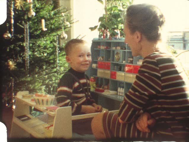 Vintage 8mm film: Christmas, 1960s, Boy playing corner store - HD stock footage clip