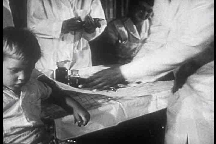 1950s - The first child receives the Salk polio vaccine in 1956. - SD stock video clip