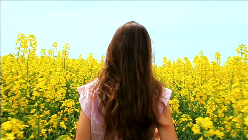 Young Woman in Vintage Dress Running through Yellow Field Touching Flowers HD - HD stock footage clip