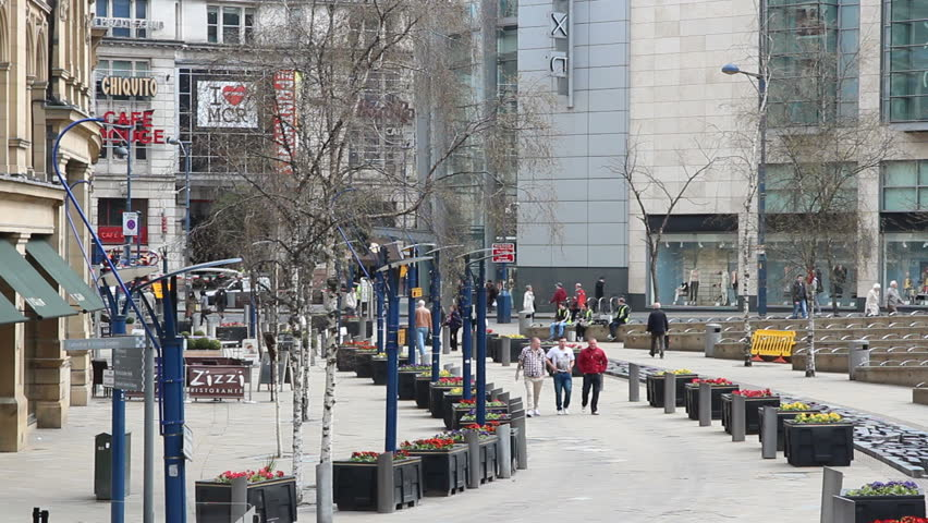MANCHESTER, UK - APRIL 22: People visit shopping area on April 22, 2013 in Manchester, UK. Greater Manchester is the 3rd most populous urban area in the UK (2.2 million people).