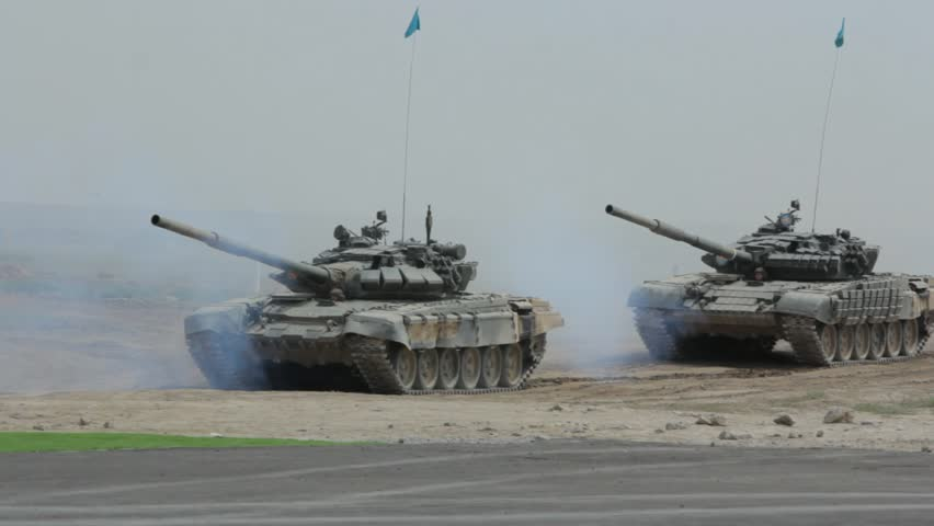 OTAR, KAZAKHSTAN - MAY 7 2013: Tanks are moving in a predetermined direction