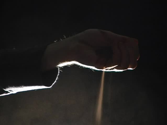 Sand and dust flowing through fingers backlit | Shutterstock HD Video #397576