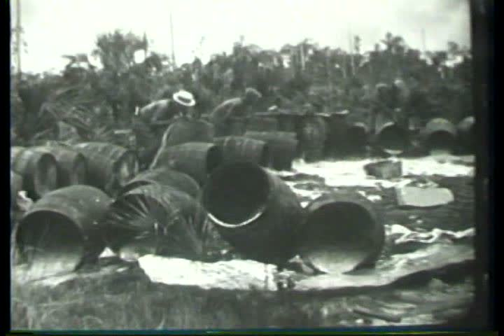 1920s - Federal officials pour out barrels of illegal moonshine during Prohibition in the 1920s. - SD stock video clip