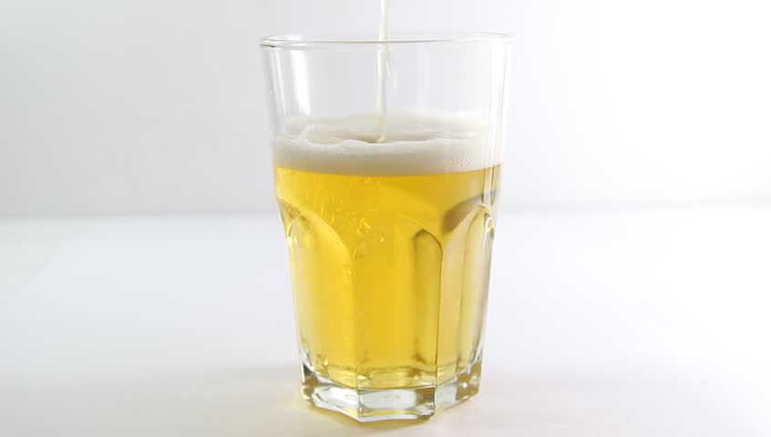 Glass of beer being poured from a bottle - HD stock video clip