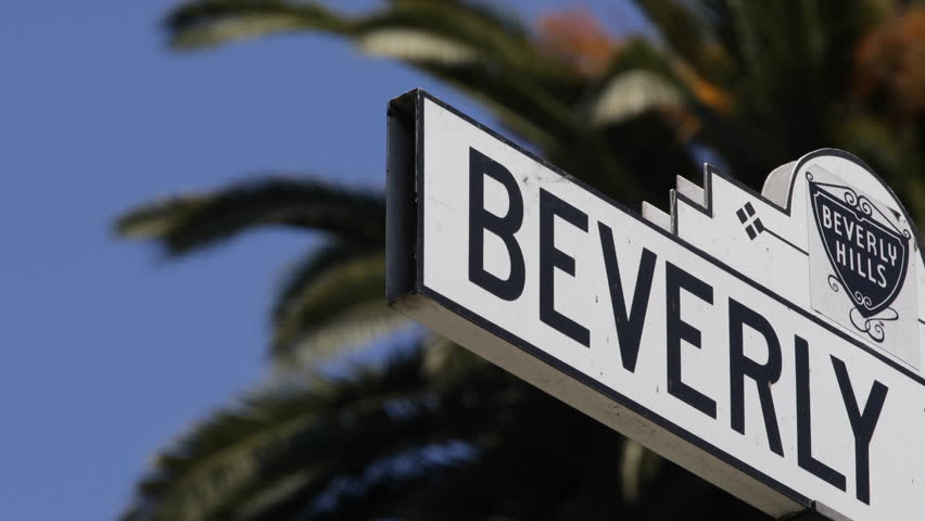 LOS ANGELES, USA - APRIL 15, 2013 The Famous Beverly Hills Sign, Trees, Street Sign, Los Angeles, California - HD stock footage clip