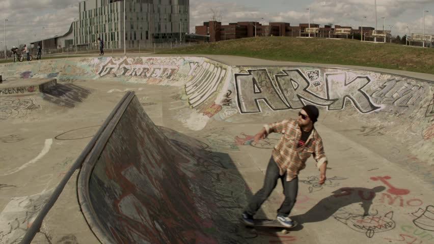 Extreme Sport Skateboarder Riding a Concrete Bowl - HD stock video clip