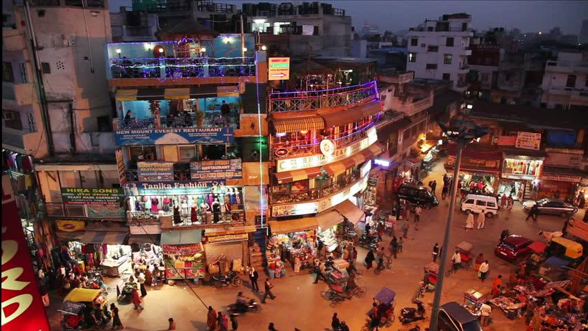 New Delhi, INDIA -January 21: Night view of Main bazar Pahar Ganj street inDelhi. People, cars, motorbikes and auto rickshaws on the street n New Delhi on January 21, 2013.