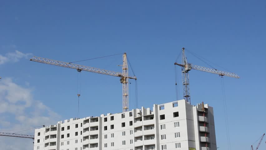Tower cranes against blue sky, with clouds. Two shots. Timelapse. - HD stock footage clip