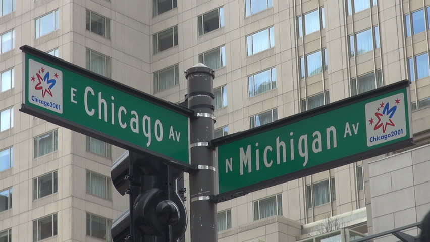 CHICAGO,USA - APRIL 17, 2013, Chicago street sign and modern building, Michigan and Chicago Avenue, Illinois,  - HD stock video clip