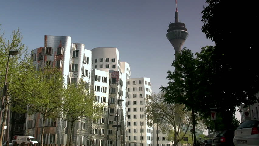DUSSELDORF, GERMANY  May 8: Dusseldorf Harbor is home to some spectacular postmodern architecture,  with contemporary status symbols signifying corporate success: Frank Gehry.,May 8, 2013, - HD stock footage clip