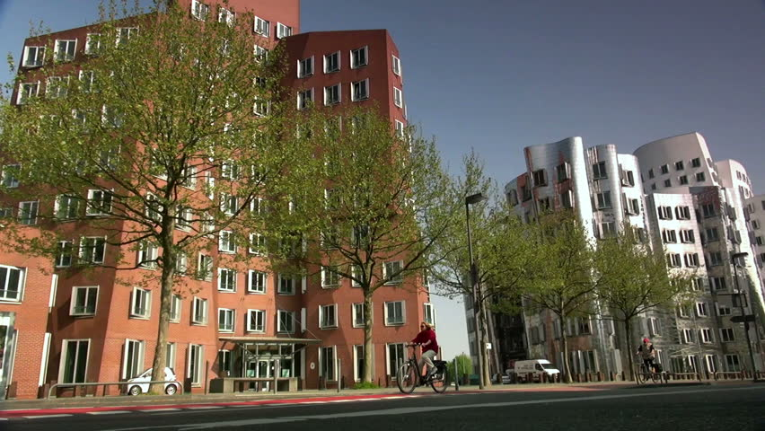 DUSSELDORF, GERMANY – May 8: Dusseldorf Harbor is home to some spectacular postmodern architecture,  with contemporary status symbols signifying corporate success: Frank Gehry.,May 8, 2013, - HD stock video clip