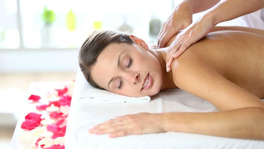 Beautiful woman receiving body massage - HD stock footage clip