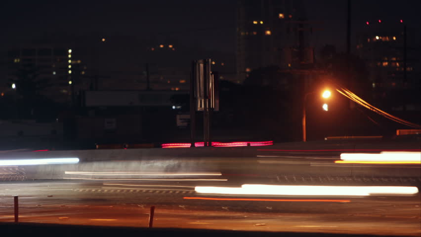 Looping night time lapse of a busy freeway with light streaks   Shutterstock HD Video #4016296
