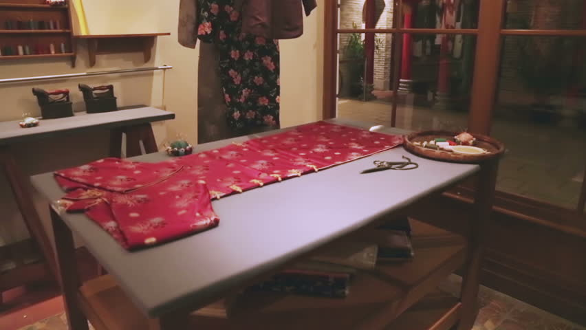 Chinese Tailor Shop. Shots of a traditional Chinese tailor shop. Close up shot of a qipao after wide shot.