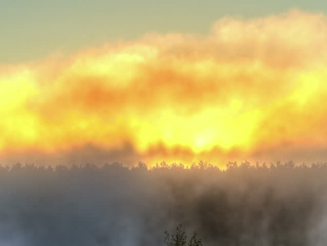 Sunrise through the mist. True HDR. Bright colors and high contrast. 4x3 - HD stock video clip