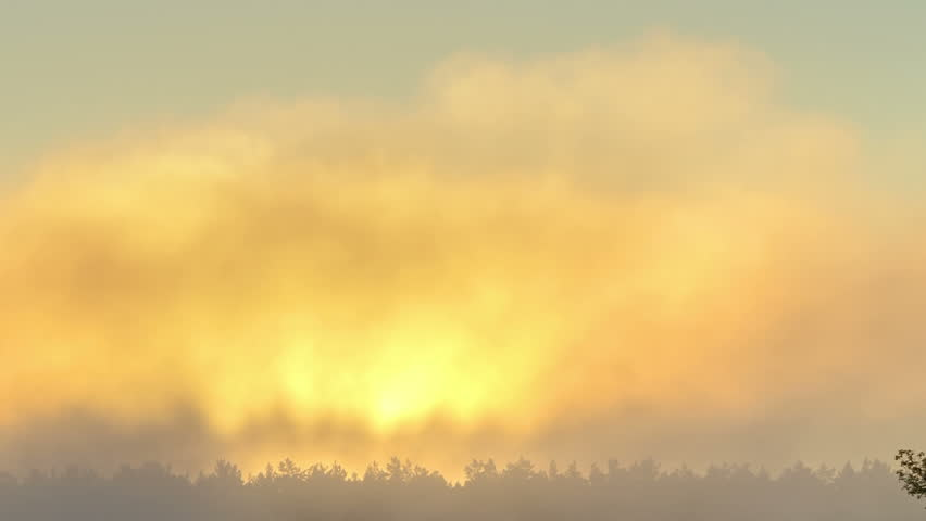 Sunrise through the mist. True HDR. Natural colors and contrast. Zoom - HD stock video clip