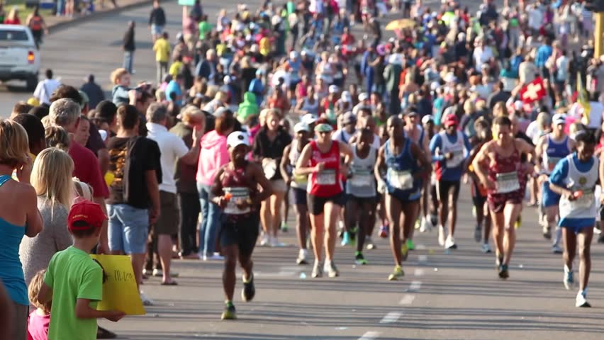 Durban, KwaZulu-Natal, South Africa - Jun 2, 2013 : A large group of supporters lined the streets of Hillcrest to cheer the comrades marathon runners on the 89km run from Durban to Pietermaritzburg.