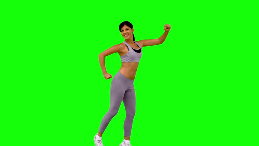Athletic woman leaping and posing on green screen in slow motion | Shutterstock HD Video #4049380