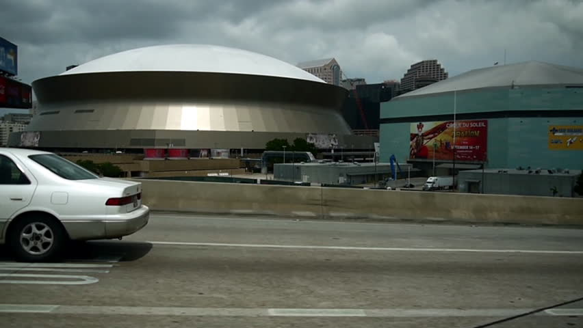 New Orleans, Louisiana -  June, 2011 - Medium driving shot of the Superdome.