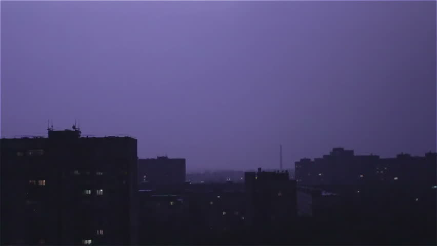 Large wide lightning bolt strikes night city, sounds of rain and thunder