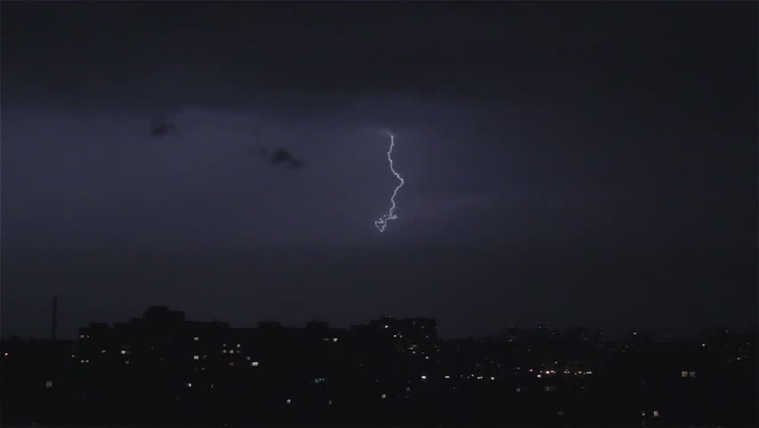 Thunder and lightning above city sky. Lightning forks to buildings, sound