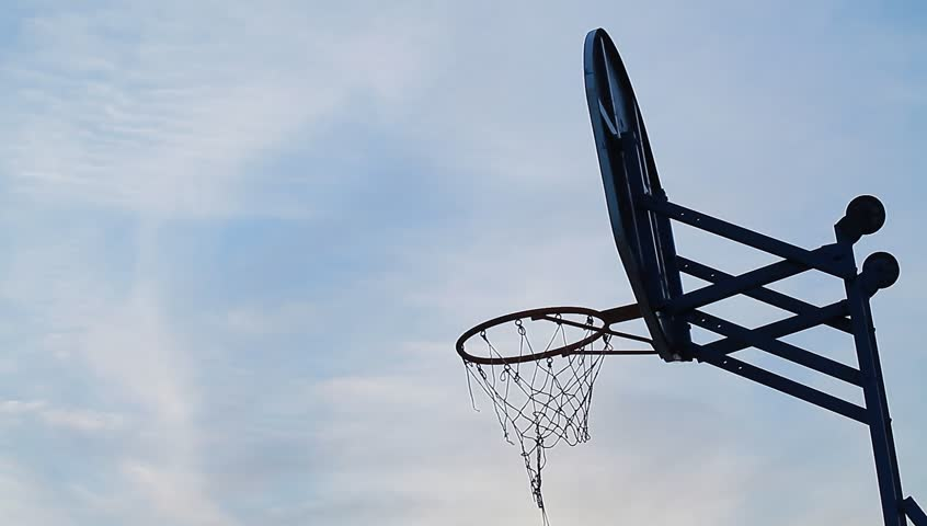 Stock video street basketball. the ball flies into the ring against the sky.hoops - HD stock video clip