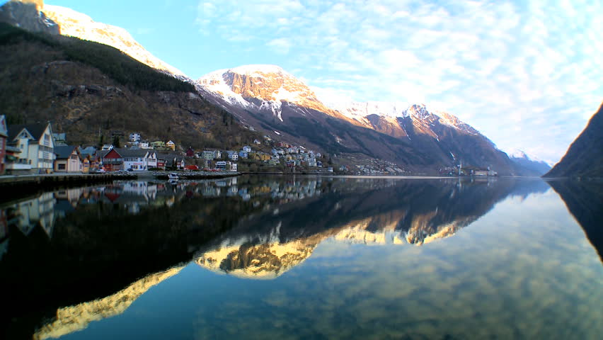 Time-lapse of oil processing refinery & small town beside a nordic fjord - HD stock footage clip