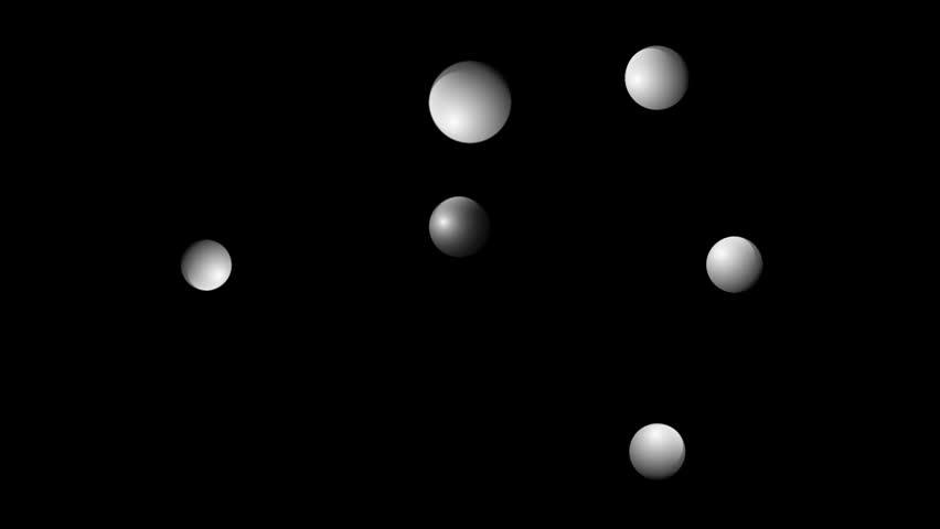 pingpong balls bouncing across a black background stock