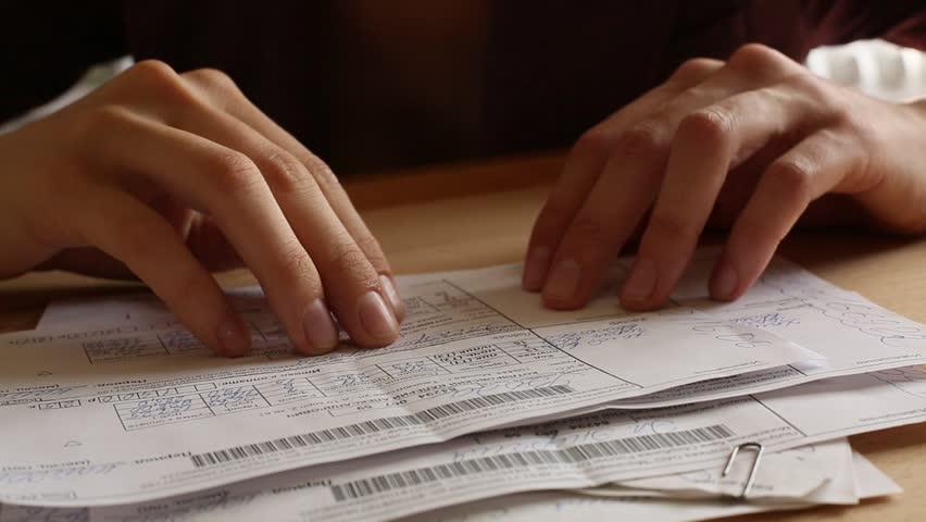 Women's hands revises paper bills (HD)
