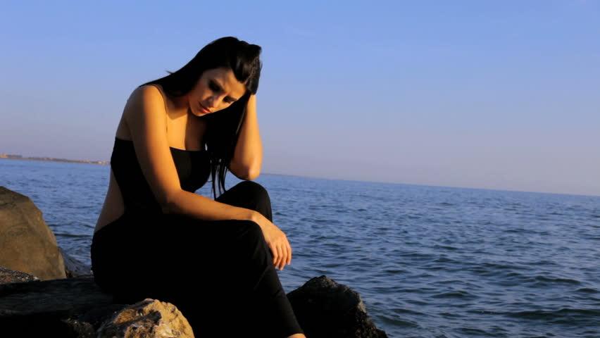 Sad Gorgeous woman sit...