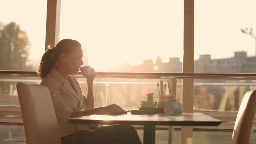 a young, beautiful woman drinking coffee
