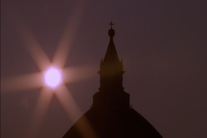 Time lapse of the midday sun rising over the top of the dome of Duomo in Florence, Italy. - SD stock video clip