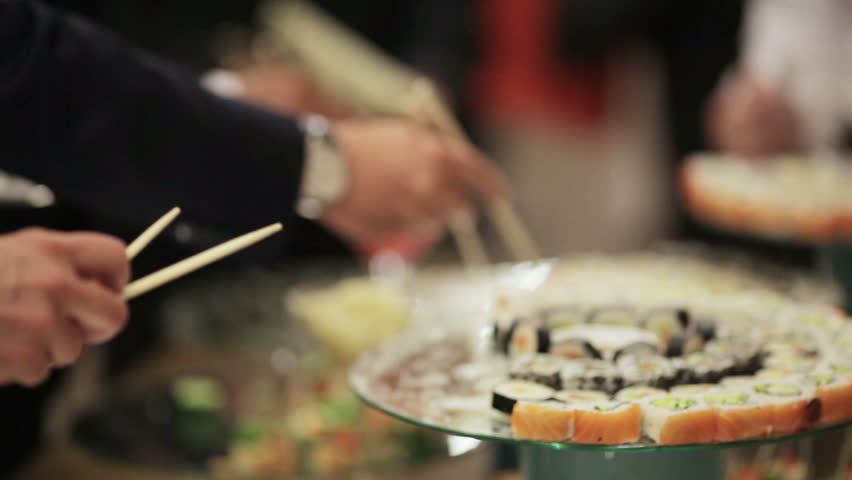 Guests take sushi on a festive cocktail party - HD stock footage clip