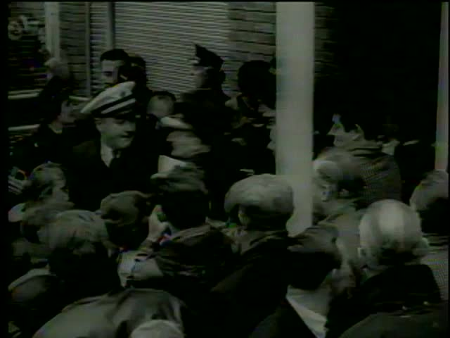 Policemen escort the Beatles through crowd of fans to the car, Heathrow Airport, London circa 1964-MGM PICTURES, UNIVERSAL-INTERNATIONAL NEWSREEL, USA, filmed in 1964