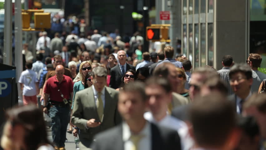 NEW YORK - CIRCA JUNE 2013: Crowd of business people walking
