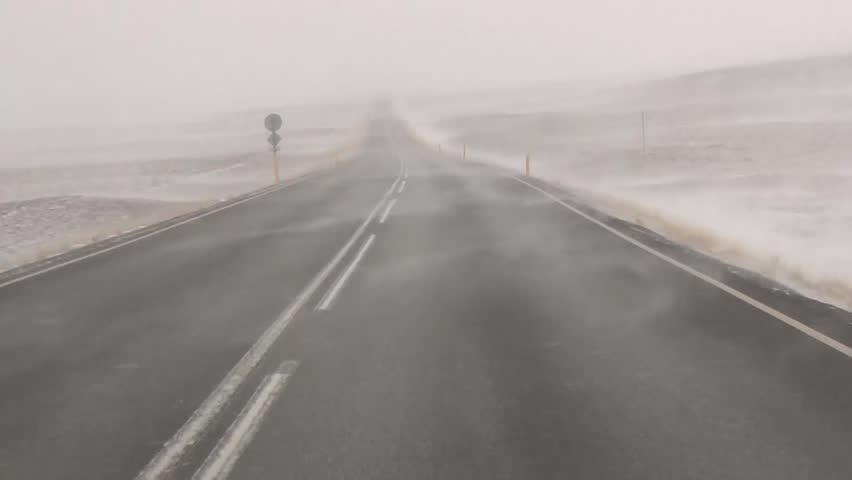 A car driving through a snowstorm in Iceland pov