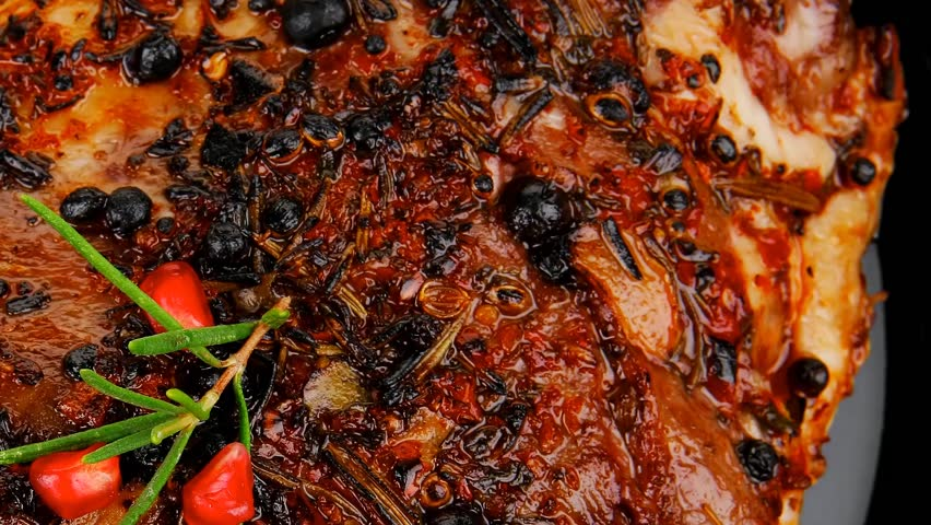 roasted ribs on black plate on wooden table - HD stock video clip