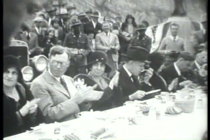 1920s - Black and white footage of president Calvin Coolidge speaking at a dam in the 1920s - SD stock footage clip