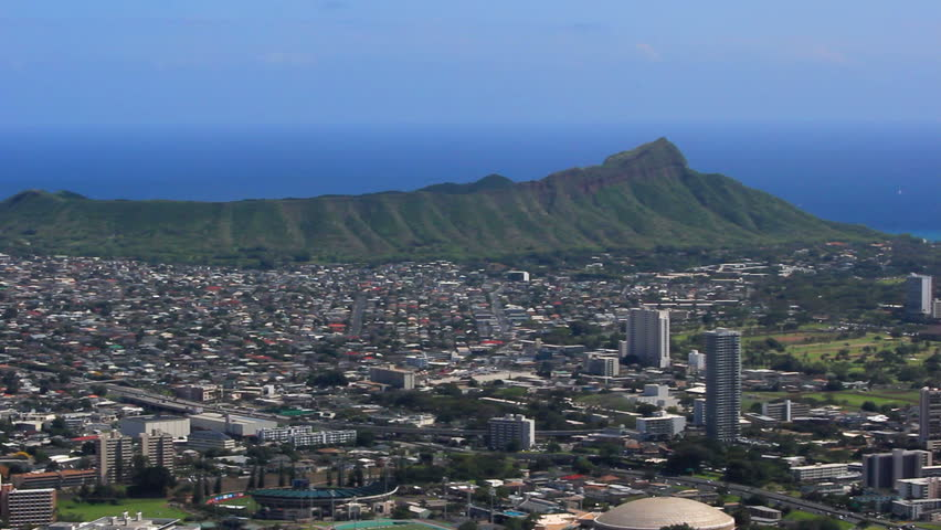Oahu, Hawaii - Pan from Diamond Head to Waikiki with Pacific Ocean and blue skies - HD stock footage clip