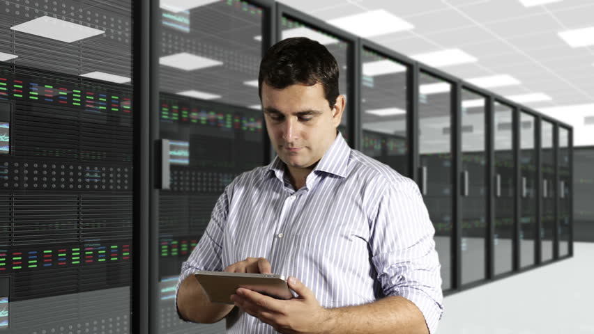 Young Man Tablet PC CPU Server Unit Room - HD stock footage clip