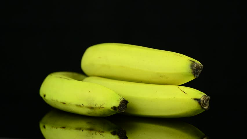 Bananas rotating on black background - HD stock footage clip