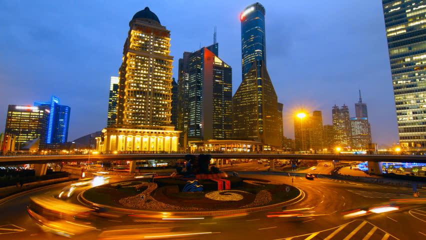 Shanghai skyscraper and city traffic at night - Shanghai, China.