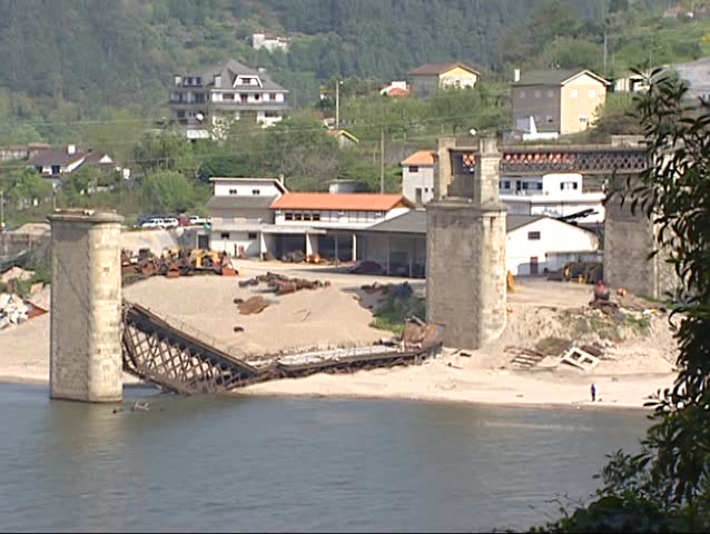 ENTRE-OS-RIOS, PORTUGAL - 18 APRIL 2001: Hintze Ribeiro Bridge at Entre-os-Rios after the collapse of March 4, 2001 - village in background.