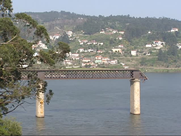 ENTRE-OS-RIOS, PORTUGAL - 18 APRIL 2001: collapsed Hintze Ribeiro Bridge, river Douro at Entre-os-Rios, Castelo de Paiva. The bridge collapsed in the night of March 4, 2001