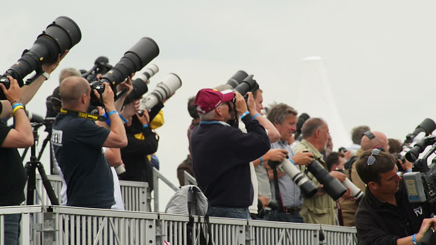 VOLKEL, NETHERLANDS - June 14 2013: Many photographer, reporter and spotter pointing her cameras in the air during an airshow at Volkel, Netherlands, June 14, 2013
