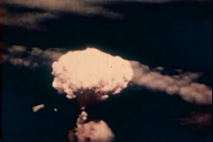 1950s - The history of nuclear bomb testing is shown. - SD stock video clip