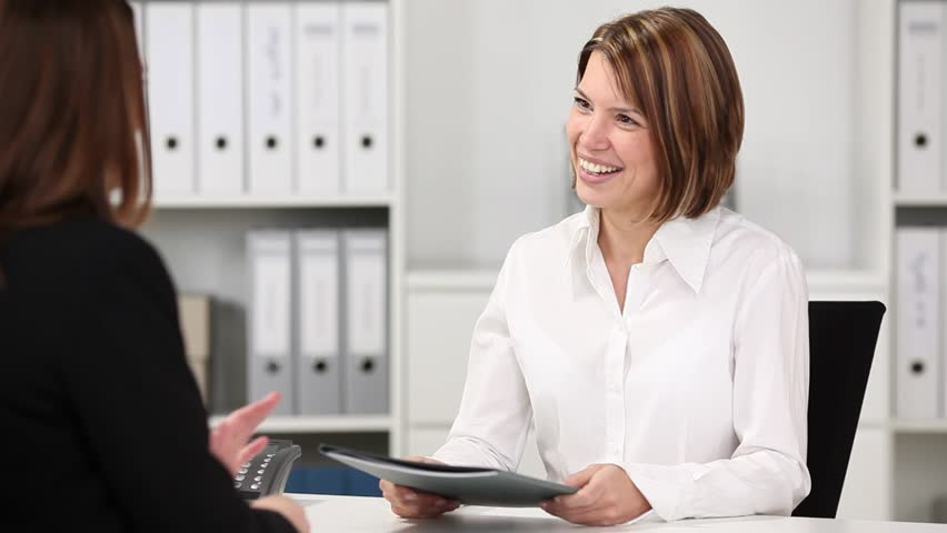 Young female candidate in job interview in office