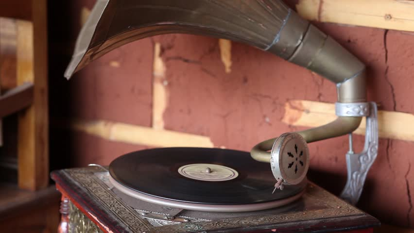 Listening the disc spinning at the old gramophone 3